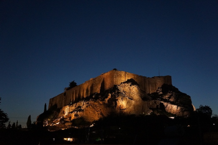 The Acropolis lit in the Athens evening sky