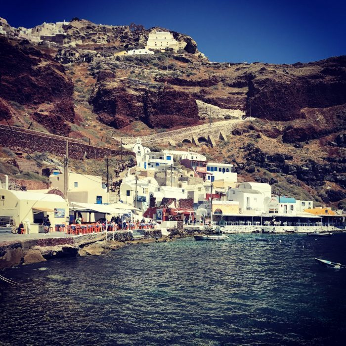 A small fishing village sitting in the Amoudi Bay below Oia, Santorini, Greece