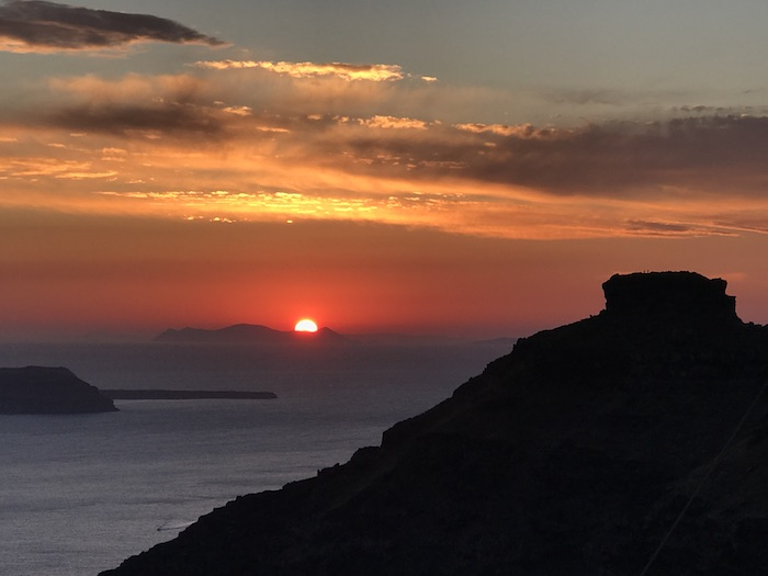 Beautiful sunset from Restaurant Onar in Firostefani, Santorini, Greece