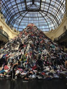An image of a mountain of used clothing waste. A piece of art in the National Museum of Fine Arts, Santiago, Chile
