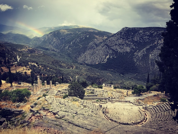 The Apollo Temple under a rainbow in Delfi, Greece