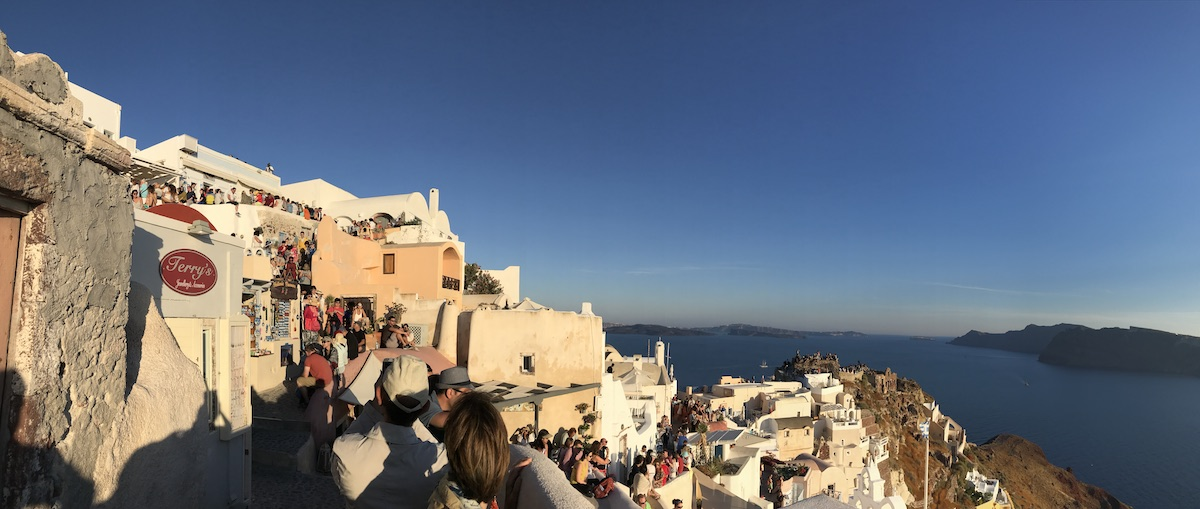 Santorini Oia sunset crowd around viewing spot