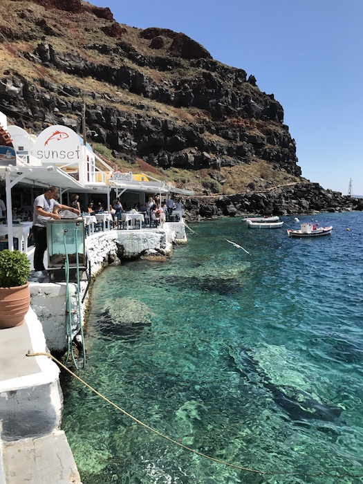 A quint fishing village sitting in the Amoudi Bay below Oia, Santorini, Greece